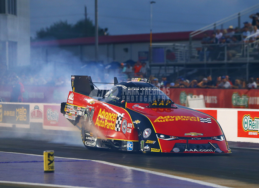 Apr 21, 2017; Baytown, TX, USA; NHRA funny car driver Courtney Force during qualifying for the Springnationals at Royal Purple Raceway. Mandatory Credit: Mark J. Rebilas-USA TODAY Sports