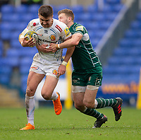 Exeter Chiefs' Henry Slade is tackled by London Irish's Theo Brophy Clews<br /> <br /> Photographer Bob Bradford/CameraSport<br /> <br /> Aviva Premiership Round 20 - London Irish v Exeter Chiefs - Sunday 15th April 2018 - Madejski Stadium - Reading<br /> <br /> World Copyright &copy; 2018 CameraSport. All rights reserved. 43 Linden Ave. Countesthorpe. Leicester. England. LE8 5PG - Tel: +44 (0) 116 277 4147 - admin@camerasport.com - www.camerasport.com