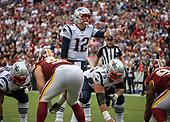 New England Patriots quarterback Tom Brady (12) calls signals during the fourth quarter of the game against the Washington Redskins at FedEx Field in Landover, Maryland on Sunday, October 6, 2019.  Also pictured are New England Patriots offensive guard Shaq Mason (69), center Ted Karras (75), and Washington Redskins defensive end Matthew Ioannidis (98) The Patriots won the game 33 - 7.  <br /> Credit: Ron Sachs / CNP
