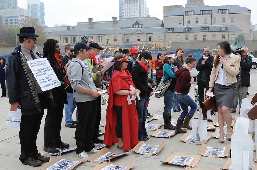 May 1, 2012, a small group of Occupy Toronto Protesters enact a piece of street theatre based upon the movement of pieces on a chess board, at Nathan Philips Square, City Hall, Toronto, Ontario, Canada.