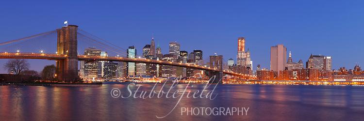 Brooklyn Bridge and Lower Manhattan as seen from Brooklyn Bridge Park at dawn.