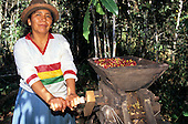 San Juan del Oro, Peru. Woman processing coffee.