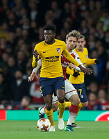Thomas Partey of Atletico Madrid & Nacho Monreal of Arsenal during the UEFA Europa League Semi Final 1st leg match between Arsenal and Atletico Madrid at the Emirates Stadium, London, England on 26 April 2018. Photo by Andy Aleksiejczuk / PRiME Media Images