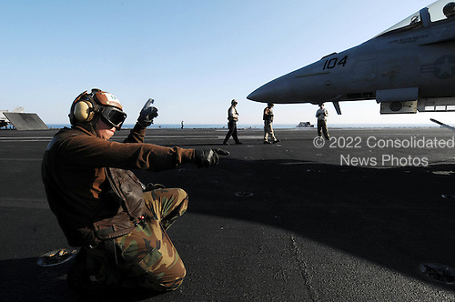 North Arabian Sea - December 7, 2009 -- Aircrew Survival Equipment Airman Joshua Matthews, assigned to the Black Aces of Strike Fighter Squadron (VFA) 41, initiates starting procedures Monday, December 7, 2009 for an F/A-18F Super Hornet aboard the aircraft carrier USS Nimitz (CVN 68). The Nimitz Carrier Strike Group is deployed to the U.S. 5th Fleet area of responsibility. .Mandatory Credit: John Phillip Wagner Jr. - U.S. Navy via CNP.