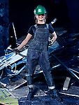 Portrait of a smiling young woman construction worker at demolition work