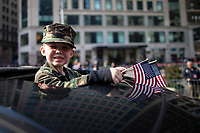 NEW YORK, USA - November 11: A kid  attends the 100 Veterans Day parade on November 11, 2019 in New York, USA. President Donald Trump, the first sitting U.S. president attended New York's parade, where he offered a tribute to veterans ahead of the 100th annual parade  (Photo by Eduardo MunozAlvarez/VIEWpress)