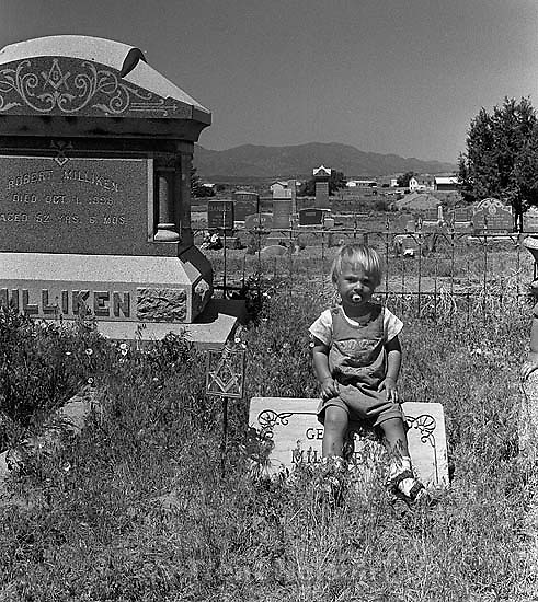 Noah Nelson on tombstone at the cemetery<br />