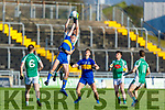 Na Gaeils Jack Barry rises above Domhnall McMahon of Michael Cusacks to make a clean catch, in the Munster Junior Club Football Championship semi final in Austin Stack Park on Saturday.