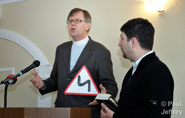 Ullas Tankler preaches at worship service in the United Methodist Church in Jabuka, Serbia. On the right is translator Daniel Sjanta.