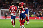 Atletico de Madrid's Thomas Teye (L) and Filipe Luis (R) during La Liga match between Atletico de Madrid and SD Huesca at Wanda Metropolitano Stadium in Madrid, Spain. September 25, 2018. (ALTERPHOTOS/A. Perez Meca)