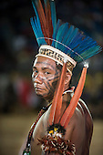 A Brazilian indigenous contestant wears his macaw feather headdress and armband at the International Indigenous Games, in the city of Palmas, Tocantins State, Brazil. Photo © Sue Cunningham, pictures@scphotographic.com 25th October 2015