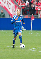 20 October 2012: Montreal Impact midfielder Justin Mapp #21 in action during an MLS game between the Montreal Impact and Toronto FC at BMO Field in Toronto, Ontario..The game ended in a 0-0 draw..
