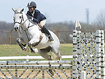 The Gazette Rachel Dantley, 12 of Upper Marlboro is in mid-air with her horse during a challenging jump at the Spring Horse Show at Show Place Arena in Upper Marlboro on Saturday.