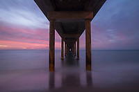 A spectacular Adelaide sunset, viewed from under the jetty at Brighton Beach.