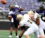 SIOUX FALLS, SD - OCTOBER 18: Delontra Fields #18 from the University of Sioux Falls has the ball jarred loose on a hit by Jared Twedt #21 and Tyler Flud #27 from Southwest Minnesota State in the first half of their game Saturday afternoon at Bob Young Field in Sioux Falls. (Photo by Dave Eggen/Inertia)