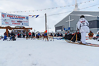 Travis Beals runs into the finish chute in Nome for 5th place during the 2019 Iditarod on Wednesday March 13<br /> <br /> Photo by Jeff Schultz/  (C) 2019  ALL RIGHTS RESERVED