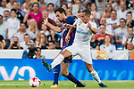 Lucas Vazquez (r) of Real Madrid competes for the ball with Sergio Busquets Burgos of FC Barcelona during their Supercopa de Espana Final 2nd Leg match between Real Madrid and FC Barcelona at the Estadio Santiago Bernabeu on 16 August 2017 in Madrid, Spain. Photo by Diego Gonzalez Souto / Power Sport Images
