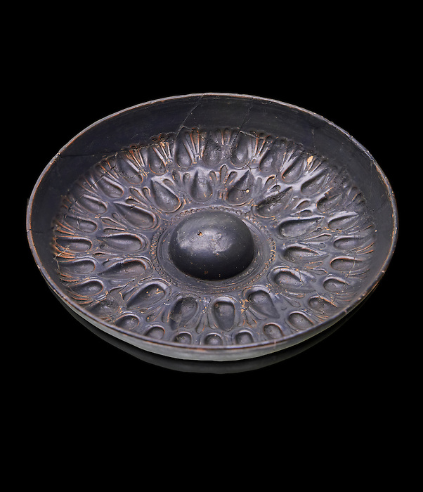 250 - 150 B.C Etruscan phiale or patera, or wine drinking bowl, produced in Calena,   National Archaeological Museum Florence, Italy, black background