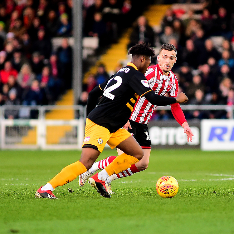 Lincoln City's Harry Toffolo vies for possession with  Newport County's Antoine Semenyo<br /> <br /> Photographer Andrew Vaughan/CameraSport<br /> <br /> The EFL Sky Bet League Two - Lincoln City v Newport County - Saturday 22nd December 201 - Sincil Bank - Lincoln<br /> <br /> World Copyright © 2018 CameraSport. All rights reserved. 43 Linden Ave. Countesthorpe. Leicester. England. LE8 5PG - Tel: +44 (0) 116 277 4147 - admin@camerasport.com - www.camerasport.com