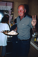 FREMONT -  Al Mangin shows off the Thanksgiving turkey in the kitchen in Fremont, California in 1985. (Photo by Brad Mangin)