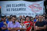 "A demonstrator holds a sign reading ""Enough morgage. Decent roof price"" as he takes part in an anti-austerity protest in Madrid on September, 2012. Hundreds of Spaniards marched in Madrid to protest over hardships in a recession brought on by the financial crisis that they blame on banks and corrupt politicians. ©  Pedro ARMESTRE"