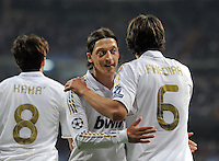 FUSSBALL   CHAMPIONS LEAGUE   SAISON 2011/2012  Achtelfinale Rueckspiel 14.03.2012 Real Madrid  - ZSKA Moskau  Mesut Oezil (Mitte, Real Madrid) umaramt Sami Khedira (re, Real Madrid)