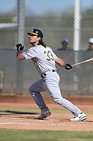 Oakland Athletics designated hitter John Jaso (33) during an Instructional League game against the Milwaukee Brewers on October 10, 2013 at Maryvale Baseball Park Training Complex in Phoenix, Arizona.  (Mike Janes/Four Seam Images)