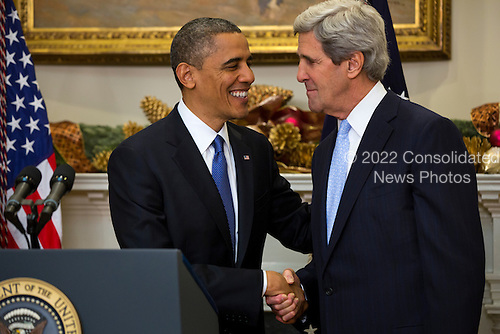 United States President Barack Obama, left, nominates U.S. Senator John Kerry (Democrat of Massachusetts), right, to be the next Secretary of State in the Roosevelt Room of the White House in Washington, DC, USA, 21 December 2012. If confirmed, Kerry will replace retiring Secretary of State Hillary Clinton early in 2013..Credit: Jim LoScalzo / Pool via CNP