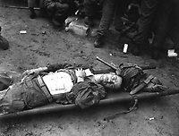 Pfc. Thomas Conlon, 21st Inf. Regt., lies on a stretcher at a medical aid station, after being wonunded while crossing the Naktong River in Korea.  September 19, 1950.  Cpl. Dennis P. Buckley.  (Army)<br /> NARA FILE #:  111-SC-348678<br /> WAR & CONFLICT BOOK #:  1449