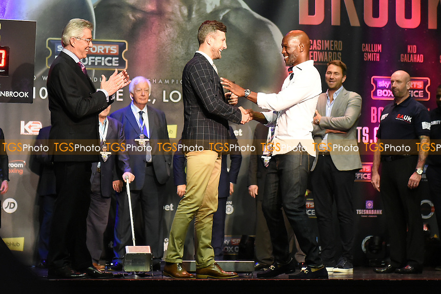 Former professional boxers Carl Froch (C) and Bernard Hopkins (white shirt) on stage during a Weigh-In at the O2 Arena on 9th September 2016