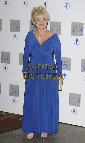 BARBARA WINDSOR .The Laurence Olivier Awards 2010, Grosvenor House Hotel, London, England. .21st March 2010.full length blue dress maxi long silver clutch bag sandals shoes sleeves .CAP/CAN.©Can Nguyen/Capital Pictures.
