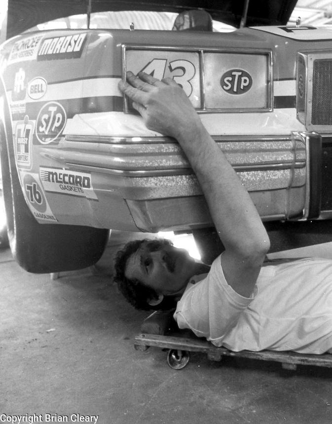 Richard Petty works under his race car before Daytona 500 at Daytona International Speedway in Daytona Beach, FL on February 1984. (Photo by Brian Cleary/www.bcpix.com)