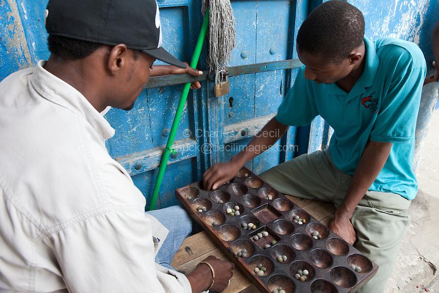 Zanzibar, Tanzania.  Men Playing Bao, a Traditional African Game.