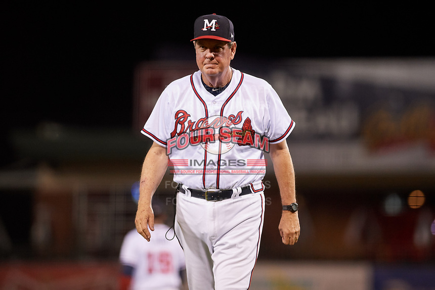 Mississippi Braves pitching coach Dennis Lewallyn (50) walks back to the dugout during a game against the Mobile BayBears on May 7, 2018 at Trustmark park in Pearl, Mississippi.  Mobile defeated Mississippi 5-0.  (Mike Janes/Four Seam Images)