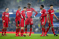 Swansea City players discuss who will take a free kick during the Premier League match between Everton and Swansea City at Goodison Park, Liverpool, England, UK. Monday 18 December 2017
