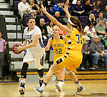 SIOUX FALLS, SD, FEBRUARY 10:  Moira Duffy #34 from the University of Sioux Falls looks for a teammate around the defense of Lynsey Prosser #22 and Hana Metoxen #31 from Augustana Friday night at the Stewart Center in Sioux Falls. (Photo by Dave Eggen/Inertia)