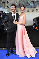 Laura Haddock &amp; Sam Claflin at the global premiere for &quot;Transformers: The Last Knight&quot; at Leicester Square Gardens, London, UK. <br /> 18 June  2017<br /> Picture: Steve Vas/Featureflash/SilverHub 0208 004 5359 sales@silverhubmedia.com