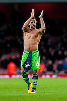 Wayne Routledge of Swansea City  applauds fans after the final of the the Barclays Premier League match between Arsenal and Swansea City at the Emirates Stadium, London, UK, Wednesday 02 March 2016