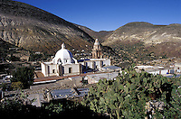 View of the old silver-mining town of Real de Catorce dominatied by the parish church, San Luis Potosi state, Mexico. Real de Catorce became a virtual ghost town during the early part of the 20th century. It has recently become a popuar destination for travellers.