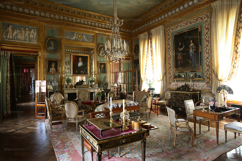"""France's ostentatious interior decorator and landscape architect, self-made man Jacques Garcia in his Norman country retreat 'le Chateau du Champ de la Bataille. He is responsible for the Parisian Ladurée teahouse and Hotel  Costes. His client list includes the Sultan of Brunei. He bought the chateau, one hours drive from Paris, at le Neubourg in Normandie, twenty years ago and faced with one of the great masterpieces of French Architecture, his self appointed task was to make it more sublime. Hardly touching the facade, he re-designed the interiors to be lavish interpretations of Baroque, recalling Louis XIV and Marie Antoinette. The stylish gardens contain Roma style temples, an amphitheatre and fountains.  The chateau, open to the public, attracts 30,000 visitors per year. In 2007, with the addition of  restaurant and hotel rooms, the project will be finished.///Chateau du Champ de la Bataille interior: """"Le Grand Salon"""" of Jacques Garcia's chateau."""