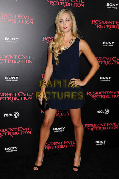 "Laura Vandervoort.""Resident Evil: Retribution"" Los Angeles Premiere held at Regal Cinemas L.A. Live, Los Angeles, California, USA..September 12th, 2012.full length dress hand on hip blue gold necklace black clutch bag   .CAP/ADM/BP.©Byron Purvis/AdMedia/Capital Pictures."