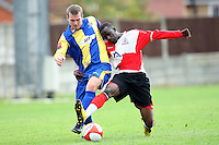Sebastian Schoburgh of Beaconsfield challenges Richard Oxby of Romford - Romford vs Beaconsfield SYCOB - FA Cup Preliminary Round Football at Mill Field, Aveley FC - 29/08/10 - MANDATORY CREDIT: Gavin Ellis/TGSPHOTO - SELF-BILLING APPLIES WHERE APPROPRIATE. NO UNPAID USE. TEL: 0845 094 6026