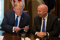 President of the United States Donald J Trump and United States House of Representatives Ways and Means Committee Chairman, Representative Kevin Brady, Republican of Texas, right, as they examine a 'simple tax card' while President Trump speaks with reporters about his proposed tax reform plan in the cabinet room during a meeting with congressional republicans at the White House in Washington, D.C. on November 2nd, 2017. Credit: Alex Edelman / CNP /MediaPunch