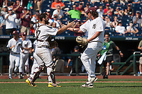Mississippi State catcher Nick Ammirati (17) and pitcher Jonathan Holder (14) congratulate each other after Game 11 of the 2013 Men's College World Series against the Oregon State Beavers on June 21, 2013 at TD Ameritrade Park in Omaha, Nebraska. The Bulldogs defeated the Beavers 4-1, to reach the CWS Final and eliminating Oregon State from the tournament. (Andrew Woolley/Four Seam Images)