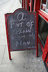 """A Pint of Plain Is Your Only Man"" sign outside Dublin pub. It's a quote a poem of the same title written by Flann O'Brien, author of The Third Policeman. Outside the Millennium pub, Parkgate St. .."