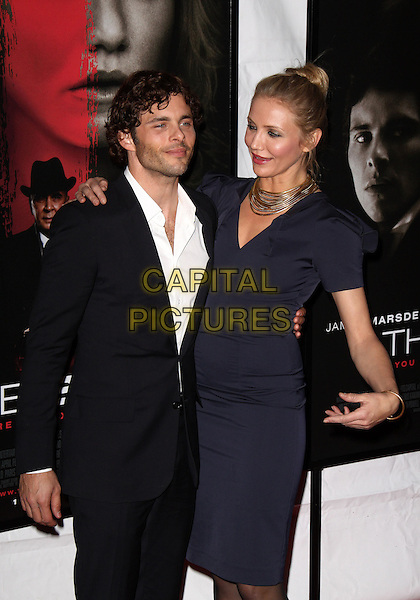 "JAMES MARSDEN & CAMERON DIAZ.""The Box"" New York City Premiere at the AMC Lincoln Square, New York, NY, USA..November 4th, 2009.half 3/4 length shirt suit jacket black white stubble facial hair gold necklaces black blue navy shoulder pads hair up hand funny profile mouth open  .CAP/ADM/PZ.©Paul Zimmerman/AdMedia/Capital Pictures."