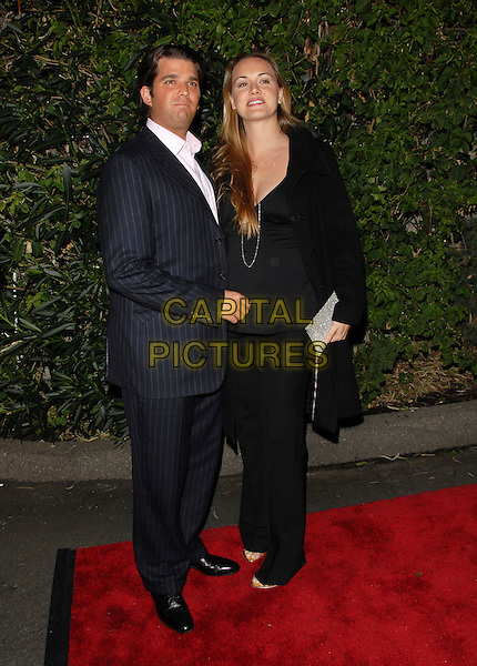DONALD TRUMP JR. & VANESSA TRUMP.Attends The Drinks America Launch Party for Trump Vodka held at Les Deux in Hollywood, California, USA. .January 17th, 2007.full length blue pinstripe suit black trousers coat pregnant couple married husband wife .CAP/DVS.©Debbie VanStory/Capital Pictures