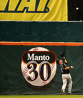 Syracuse Chiefs outfielder Corey Brown #21 tracks down a fly ball in front of the Jeff Manto retired jersey display during a game against the Buffalo Bisons at Coca-Cola Field on September 1, 2011 in Buffalo, New York.  Syracuse defeated Buffalo 6-2.  (Mike Janes/Four Seam Images)