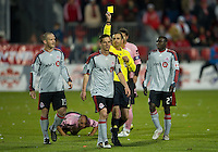 28 April 2010: Toronto FC midfielder Sam Cronin #2 receives a yellow card from referee Paul Ward during a Nutrilite Canadian Championship game between the Montreal Impact and Toronto FC at BMO Field in Toronto..Toronto FC won 2-0.....
