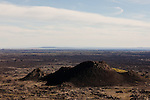 A volcanic cinder cone rises up from the lava bed in Craters of the Moon National Monument, Idaho.